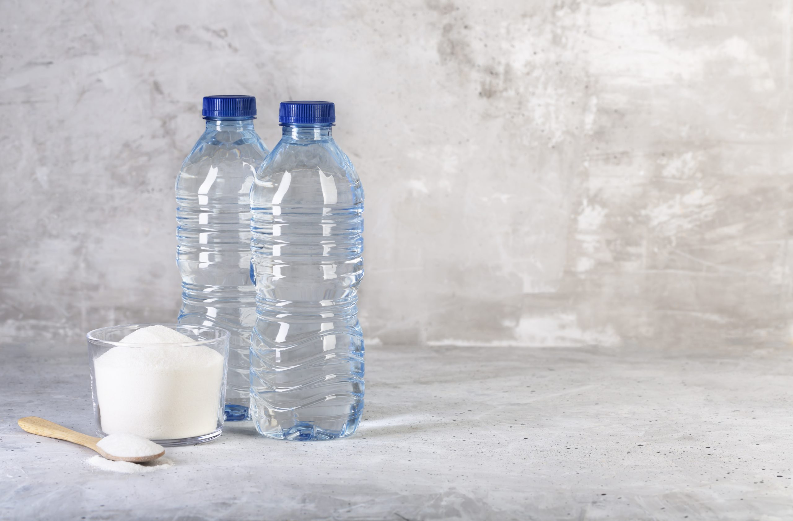 Collagen protein powder and two bottles of water - Hydrolyzed